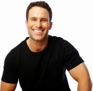 A handsome man smiling against white background